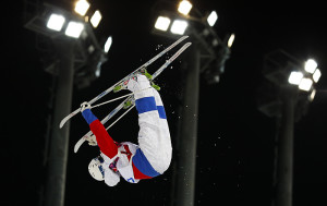 Russia's Smyshlyaev performs a jump during the men's freestyle skiing moguls finals at the 2014 Sochi Winter Olympic Games in Rosa Khutor