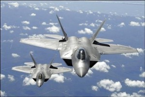 us-air-force-f-22-raptor-aircraft-flying-in-trail-behind-a-kc-135r-stratotanker